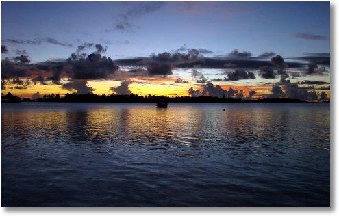 sunset at conrad rangali island maldives