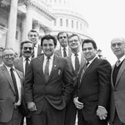 Members on the Capitol steps