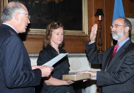 Secretary of the Interior Ken Salazar swears in Michael Bromwich as the new Director of the Bureau of Ocean Energy Management, Regulation, and Enforcement on June 21 as Betsy Hildebrandt, DOI Communications Director holds the Bible.