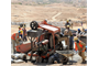 AFGHANISTAN — Workers mix and move concrete to lay the perimeter wall foundation at the U.S. Army Corps of Engineers Afghanistan Engineer District-South