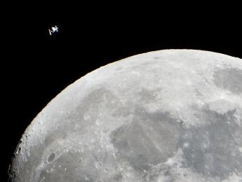 Space Station Flying by the Moon