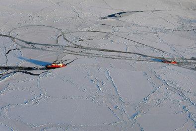 The Healy, left, a Coast Guard icebreaker, carves a path in the frozen Bering Sea for the Renda, a Russian tanker carrying 1.3 million gallons of emergency gasoline and diesel for Alaska. Shipping delays and a major storm prevented Nome's winter supply of fuel from arriving in early fall.