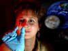 Dr. Lisa Monaco, project scientist for the Lab-on-a-Chip Applications Development program, examines a prototype chip.