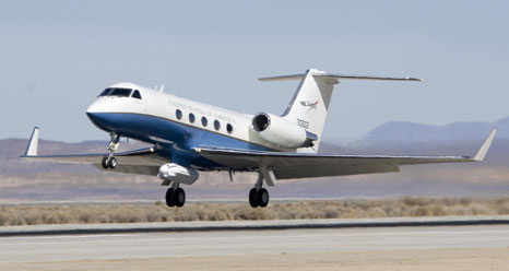 NASAs Gulfstream-III research testbed lifts off from the Edwards Air Force Base runway with the UAV synthetic aperture radar pod under its belly.