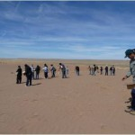This image shows USGS scientists working with students and members of tribal nations to plant seeds on the sand dunes in the southwest as a means to help facilitate plant growth and dune stabilization. The USGS is studying conditions in this area and helping decisionmakers identify strategies to maintain sand dune stability and enhance the area's ecology. You can find out more about the USGS project at http://geomaps.wr.usgs.gov/navajo.
