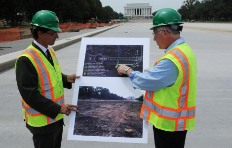 Secretary Salazar with National Park Service Deputy Director for the Mall and Monuments Steve Lorenzetti look over a map of the renovations to the Lincoln Memorial Reflecting Pool.