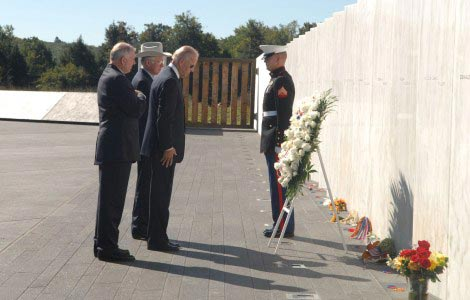 Vice President Biden, Secretary Salazar, and President of the Families of Flight 93, Patrick G. White, pause after laying a wreath at The Wall of Names at the Flight 93 National Memorial.
