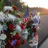 Flowers and a US flag at the Flight 93 Memorial