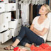 Photo of a woman in a cluttered closet.
