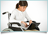 young girl in wheel chair with laptop