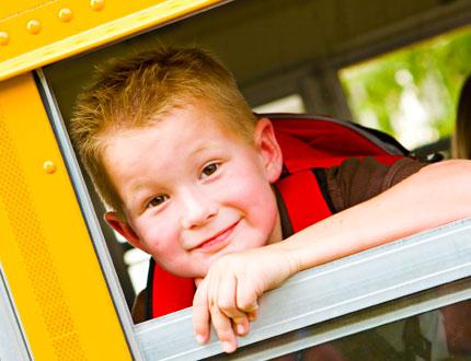 Boy in a schoolbus
