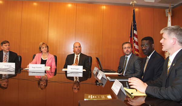 Six of USPTO's leaders sitting around a table