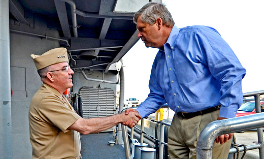 U.S. Navy Fleet Forces commander Admiral John C. Harvey, Jr. greets Secretary Vilsack during a tour of the guided- missile cruiser. Navy photo Rafael Martie.