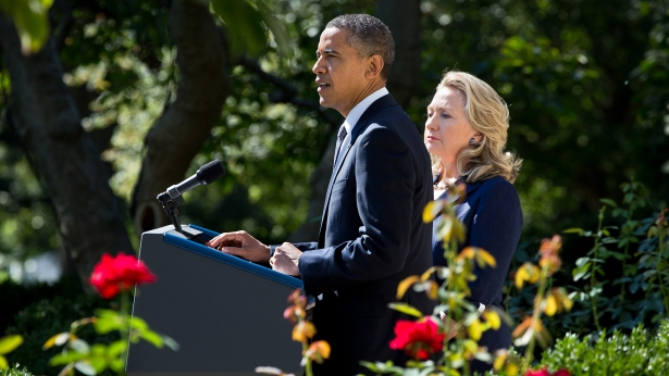 President Obama, with Secretary of State Clinton, delivers a statement