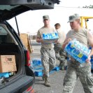 Photo: 120901-A-SM895-078  NEW ORLEANS - Airmen from the Louisiana National Guard's 259th Air Traffic Control Squadron distribute food, water and ice to citizens in need of resources after Hurricane Isaac in New Orleans, Sep. 1, 2012. The LANG has more that 6,000 Soldiers and Airmen on duty to support our citizens, local and state authorities by conducting Hurricane Isaac operations. (U.S. Army photo by Spc. Tarell J. Bilbo, 241st Mobile Public Affairs Detachment/RELEASED) Digital