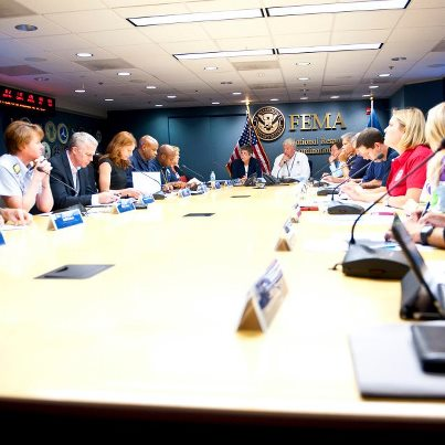 Photo: August 30 - DHS Secretary Janet Napolitano (head of the table) participates on the daily FEMA meeting regarding Hurricane Isaac response.  Seated around the table are numerous agencies and departments of the federal government, who are closely coordinating response and recovery efforts.
