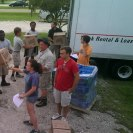 Photo: NCCC - Delta 6 members unloading supplies at the Hammond Westside Upper Elementary shelter in Hammond, LA.