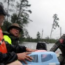 Photo: From The National Guard A Soldier with the Mississippi Army National Guard's 2nd Battalion, 20th Special Forces Group (Airborne) helps a sheriff's deputy evacuate a local resident and his two dogs from a flooded area along the Mississippi coast during Hurricane Isaac relief operations.(U.S. Army photo by Staff Sgt. David Hamann)