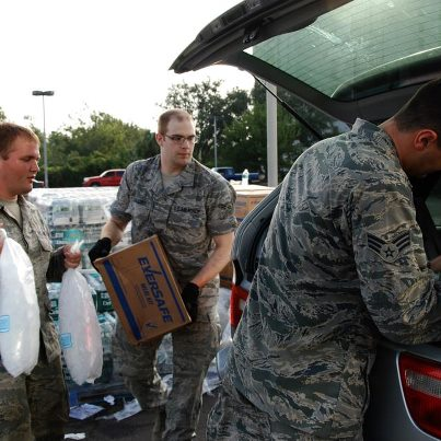 Photo: 120901-A-SM895-018  NEW ORLEANS - Airmen from the Louisiana National Guard's 259th Air Traffic Control Squadron distribute food, water and ice to citizens in need of resources after Hurricane Isaac in New Orleans, Sep. 1, 2012. The LANG has more than 6,000 Soldiers and Airmen on duty to support our citizens, local and state authorities by conducting Hurricane Isaac operations. (U.S. Army photo by Spc. Tarell J. Bilbo, 241st Mobile Public Affairs Detachment/RELEASED) Digital