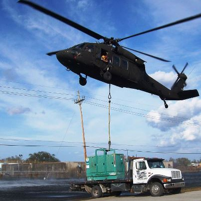 Photo: PORT SULPHUR, La. – A Louisiana Army National Guard UH-60 Black Hawk helicopter transports a much-needed 5,000-pound generator to a water treatment plant in Plaquemines Parish after flooding caused by Hurricane Isaac, Sept. 5, 2012. (U.S. Army photo by 1st. Sgt. Kevin M. Currie, 1-244th Assault Helicopter Battalion/RELEASED)