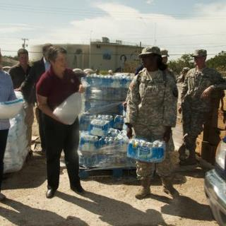Photo: Slidell, La., Sep. 2, 2012 -- DHS Sec. Janet Napolitano along with Sen. Mary Landrieu (D-La.) joins a member of the Louisiana National Guard in distributing ice to residents in Slidell, La., who were affected by Hurricane Isaac. Napolitano visited LA and MS to assess the current needs of the areas affected by Hurricane Isaac. Napolitano has ordered FEMA to provide assistance to the affected areas.