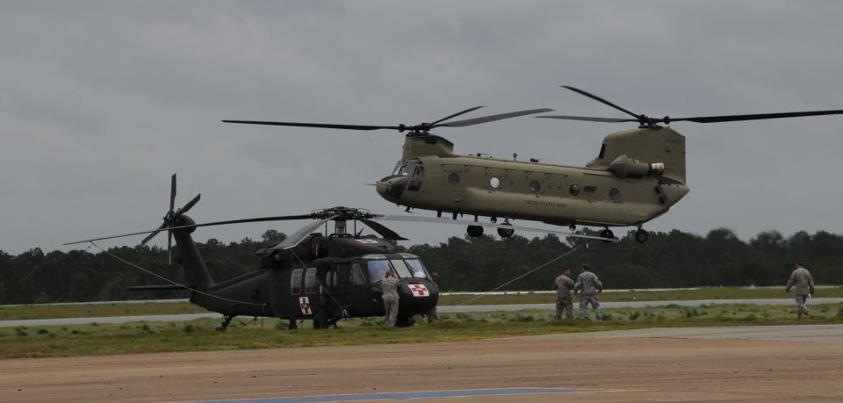 Photo: August 30 photo from NORAD and USNORTHERN Command -  Soldiers from the 7th Battalion, 101st Aviation Regiment, 159th Combat Aviation Brigade, 101st Airborne Division land at Cairns Army Airfield, Fort Rucker, Ala., as a staging area awaiting the call to assist relief efforts resulting from Hurricane Isaac. The Soldiers and a  combination of HH-60 Alpha Plus Black Hawk and CH-47F Chinook helicopters stand ready to support our federal and State partners. (U.S. Army photo by Kelly Pate)