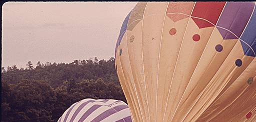 Photo: Hot air balloons being inflated with propane burners outside of Helen, Georgia for the second annual Helen to Atlantic ocean balloon race. May, 1975 Documerica by Al Stephenson.  This month, the Documerica Returns Exhibit is traveling with U. S. Environmental Protection Agency Region 4 (Southeast Region) making stops throughout Georgia and North Carolina. For a schedule and other area images check out http://bit.ly/DocumericaExhibitGA