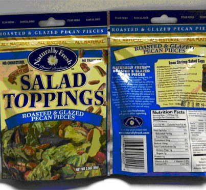Photo: http://go.usa.gov/r5Y3  Bay Valley Foods is voluntarily recalling packages of Naturally Fresh® Roasted & Glazed Pecan Pieces Salad Toppings because some of the packages may contain almonds that are not listed in the ingredient statement. Consumers who have allergies to almonds run the risk of a serious or life threatening allergic reaction if they consume the mislabeled product.