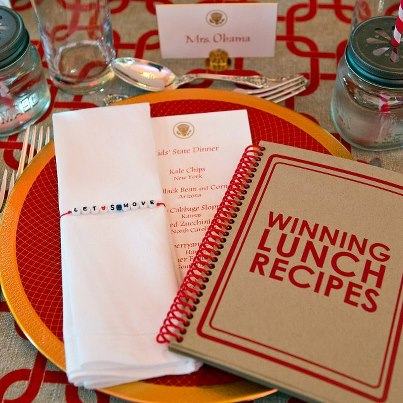 Photo: A booklet of the winning lunch recipes is included as part of the place setting at the Kids' State Dinner in the East Room of the White House, Aug. 20, 2012. (Official White House Photo by Sonya N. Hebert)