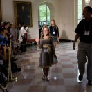 "Photo: Kayla Wayman, 9, from Montana, waves to the media in the East Garden Room as she arrives for the Kids' State Dinner at the White House, Aug. 20, 2012. Kayla submitted a recipe for ""Kayla's Garden Chicken Pizza"". (Official White House Photo by Sonya N. Hebert)"