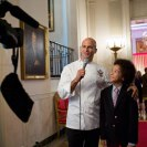 Photo: Sam Kass, Senior Policy Advisor for Healthy Food Initiatives, interviews Kids' State Dinner guest Samuel Hightower, 10, from Maryland, in the Cross Hall of the White House, Aug. 20, 2012. Samuel's winning recipe was for Sizzling Tofu with Green Onions and Sugar Snap Peas. (Official White House Photo by Sonya N. Hebert)