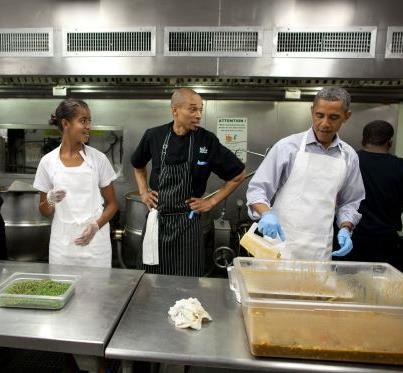 Photo: Photo: President Obama and daughter Malia participate in a service project to commemorate the September 11th National Day of Service and Remembrance at DC Central Kitchen in Washington, D.C., Sept. 10, 2011. (Official White House Photo by Pete Souza)   Learn more about service opportunities in your area & sign up to join the 9/11 Day movement: http://www.serve.gov/
