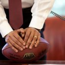 Photo: President Barack Obama leans on a football while making a phone call in the Oval Office on June 24, 2009. (Official White House Photo by Pete Souza)