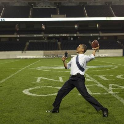 Photo: President Barack Obama throws a football on the field at Soldier Field following the NATO working dinner in Chicago, Ill., May 20, 2012. (Official White House Photo by Pete Souza)
