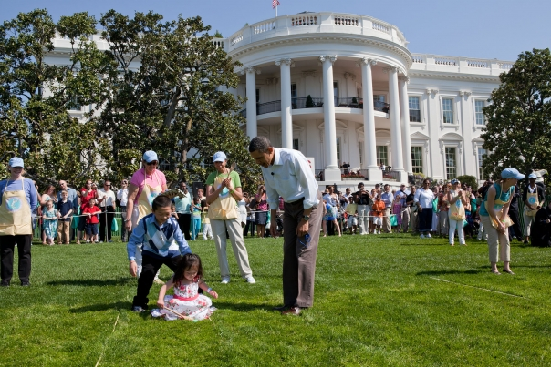 President Barack Obama cheers on kids taking part in the Easter Egg Roll on the South Lawn of the White House