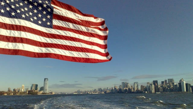 USA Flag flaying on ship in New York Harbor