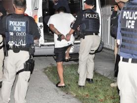 ICE officials arrest a criminal alien