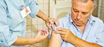 Man gets flu vaccine