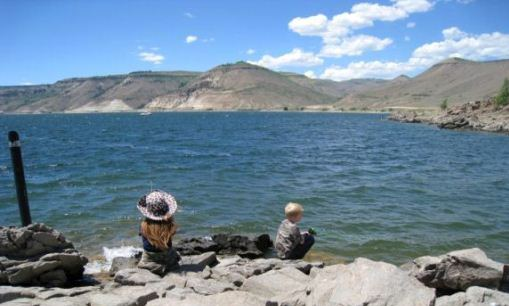 Children fishing at Blue Mesa Reservoir in Colorado