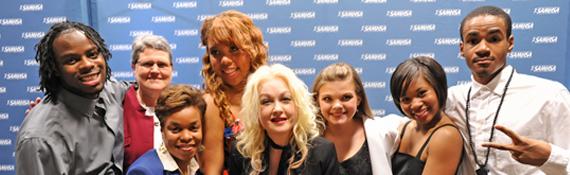 Cyndi Lauper celebrated with youth, SAMHSA Administrator Pamela S. Hyde, and SAMHSA Public Health Advisor Jorielle Brown.