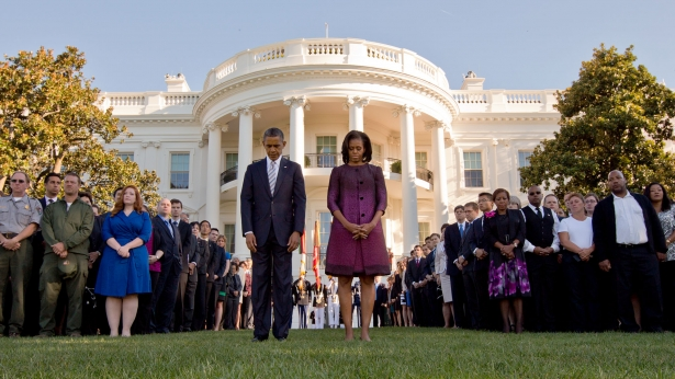 President Obama and First Lady Michelle Obama observe a moment of silence