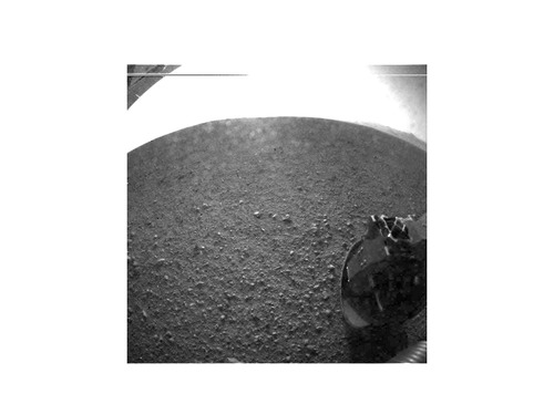 """Image description: This is one of the first images taken by NASA's Curiosity rover, which landed on Mars the evening of Aug. 5 PDT (morning of Aug. 6 EDT). It was taken through a """"fisheye"""" wide-angle lens. As planned, the rover's early images are lower resolution. Larger color images from other cameras are expected later in the week. View more images from Curiosity. Image from NASA/JPL-Caltech"""
