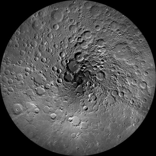 Image description:This photo of the moon's north polar region was taken by NASA's Lunar Reconnaissance Orbiter Camera, or LROC. One of the primary scientific objectives of LROC is to identify regions of permanent shadow and near-permanent illumination. Since the start of the mission, LROC has acquired thousands of wide angle camera images and combined them to produced this mosaic, which is composed of 983 images taken over a one month period during northern summer. Image courtesy ofNASA