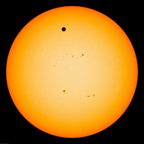 Image description: Venus passing across the face of the sun, producing a silhouette that no one alive today will likely see again.   Watch NASA's live coverage of the Transit of Venus.  Image from NASA's Astronomy Picture of the Day.