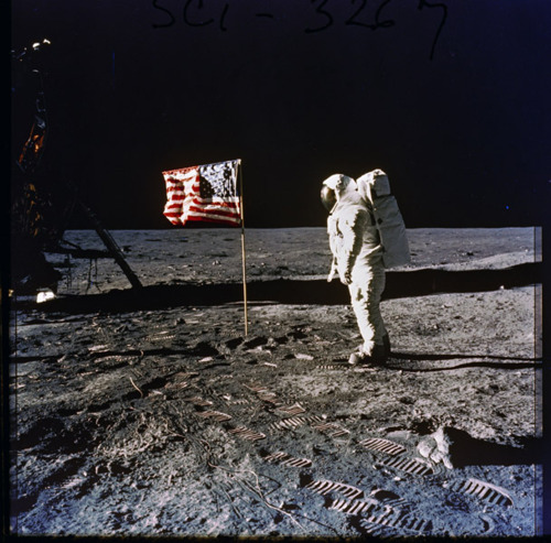 """From the U.S. Presidential Libraries:  First moon walk. July 20, 1969. Photo of Astronaut Edwin E. """"Buzz"""" Aldrin on the surface of the moon, next to the U.S. flag. Photographed by Neil Armstrong, first person to set foot on the moon. Apollo 11 mission. -via The National Archives, Nixon Administration"""