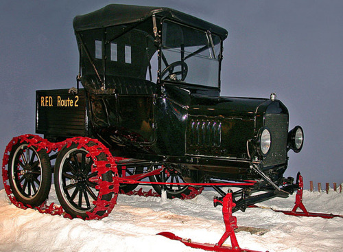 """Image description: This 1921 Ford Model T was owned by rural mail carrier Harold Crabtree of Central Square, NY. The vehicle is fitted with the """"Mailman's Special"""" attachment to help it travel through deep snow.Learn more about the Ford Model-T snowmobile attachment. Photo from the National Postal Museum"""