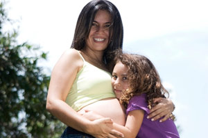 pregnant woman and her daughter