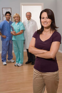 Woman with a team of doctors and nurses