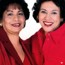Two women pose on the cover of Spanish materials.