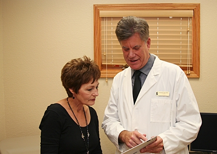Dr. Randall Oates of SOAPware and his administrative assistant Fay Sanford access an Electronic Health Record on a tablet computer.